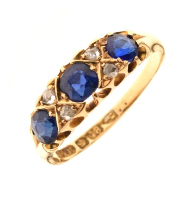 Lot 13 - Blue garnet topped doublet and diamond 18ct gold ring