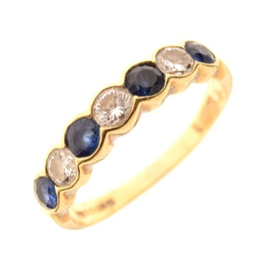 Lot 29 - 18ct gold half hoop ring, set with four sapphire and three brilliant cut diamonds
