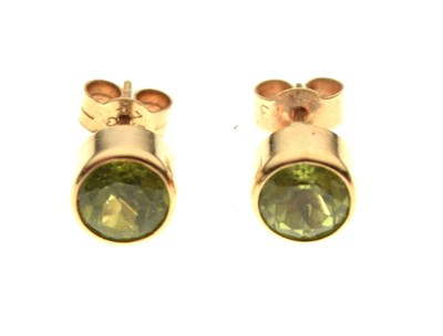 Lot 31 - Pair of 9ct gold and peridot ear studs