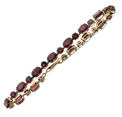 Lot 42 - 9ct gold bracelet set purple stones
