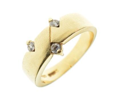 Lot 7 - Yellow metal (750) ring set three white stones