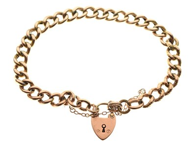 Lot 47 - Yellow metal curb-link charm bracelet with 9ct gold padlock