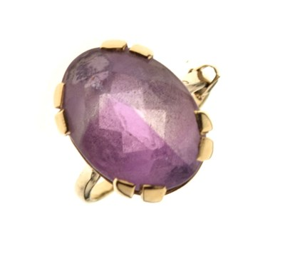 Lot 8 - 9ct gold dress ring set oval amethyst-coloured stone
