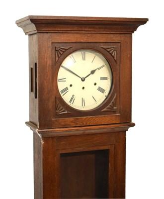 Lot 375 - Early 20th Century oak longcase clock