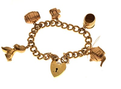 Lot 42 - Gold-plated charm bracelet with 9ct charms