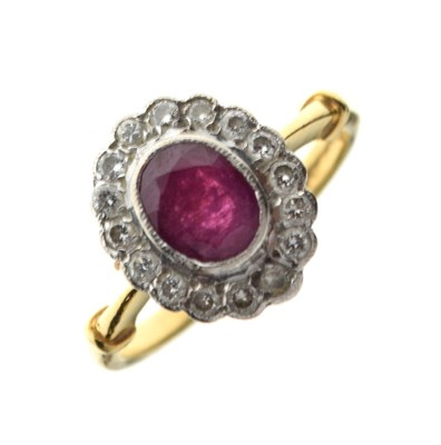Lot 32 - 18ct gold, ruby and diamond cluster ring