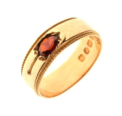 Lot 23 - 18ct gold band set garnet-coloured stone, size O, 5.3g gross approx