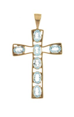 Lot 79 - 9ct gold cross pendant set seven blue topaz stones