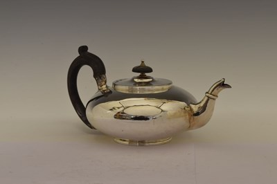 Lot George III silver teapot of squat form with scroll handle