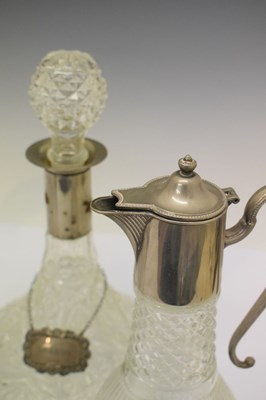 Lot 336 - Two silver decanter labels, London 1972 and 1973, claret jug, decanters, etc
