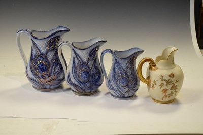 Lot 347 - Royal Worcester flatback jug and graduated set of three Victorian relief-moulded jugs