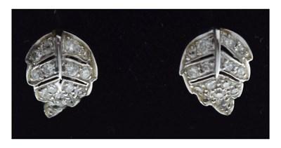 Lot 65 - Pair of unmarked white metal leaf design diamond set stud earrings