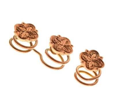 Lot 94 - Three small rose gold flower design studs