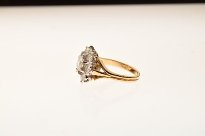 Lot Nine stone diamond cluster ring, the yellow mount stamped '18'